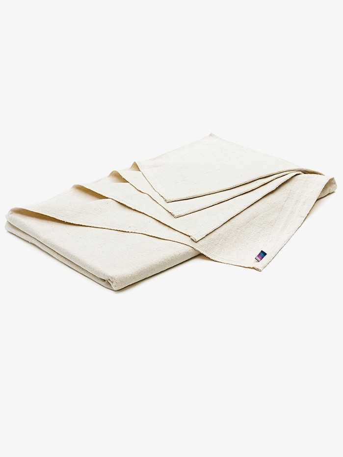 This image has an empty alt attribute; its file name is yogamatters-cotton-blanket-natural-web.jpg